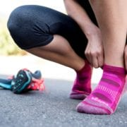 Woman putting on her racing socks