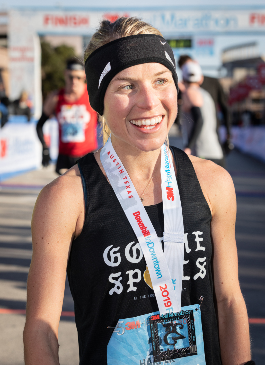 Jess Harper is all smile after her second 3M Half Marathon victory in as many years.