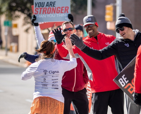 CG trainers cheer on runners at the 2019 3M Half Marathon. Expand your summer training with Camp Gladiator trainers!